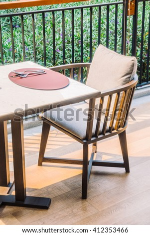Empty chair and table setting for dinning in restaurant - Vintage Light Filter