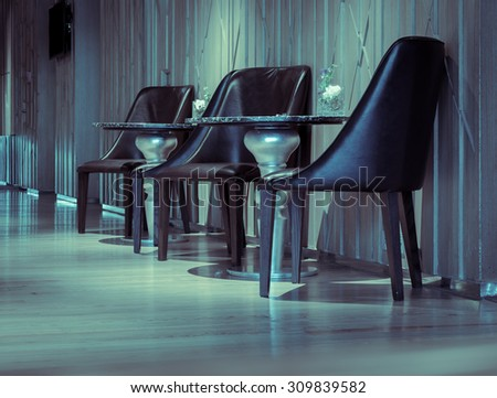 Empty chair at the hotel lobby in retro style - stock photo