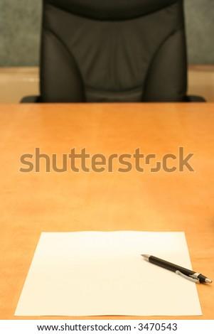 Empty chair, empty paper. - stock photo