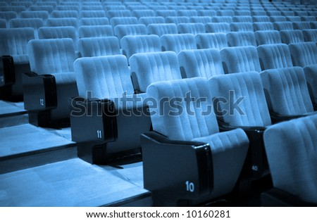Empty chairs at cinema or theater. Blue Tone - stock photo