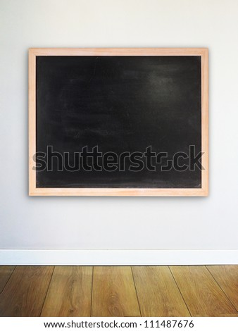 Empty chalk board on the modern wall - stock photo