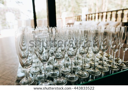 empty Champagne glasses closeup, Wedding reception alcohol  drink table - stock photo