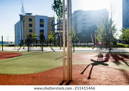 Empty children playground in the city  - stock photo