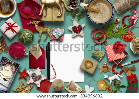 empty Christmas card, collection, gifts and decorative ornaments, on blue background. photographic montage - stock photo