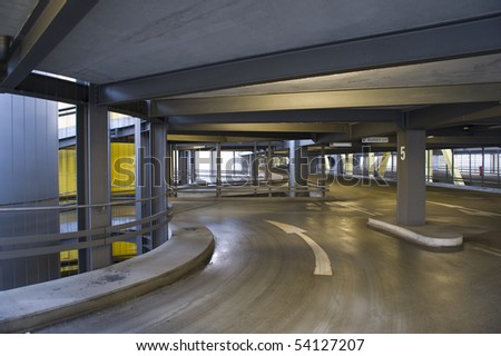 Empty circular parking garage ramp at airport