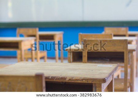 Empty classroom with chairs and desks  : selective focus - stock photo