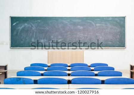 empty classroom with tables and chairs - stock photo
