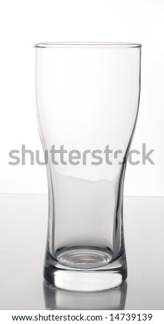 Empty clear beer glass on white