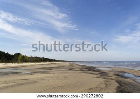 Empty coast in spring - stock photo