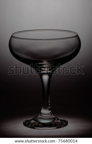 Empty cocktail glass on a black background