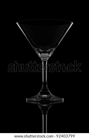 Empty cocktail glass on black background sharp light and reflect - stock photo