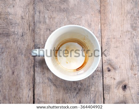 Empty coffee cup after drink on wood table - stock photo