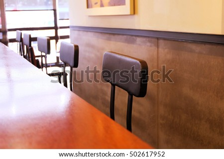 Empty coffee shop with tables and chairs .