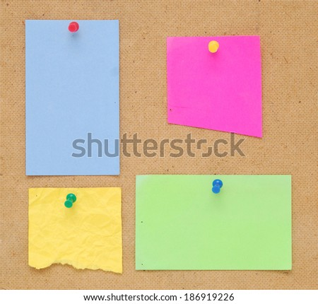 empty color notes on wooden background