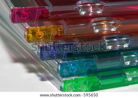 Empty colorful CD DVD Jewel cases stacked on each other - stock photo