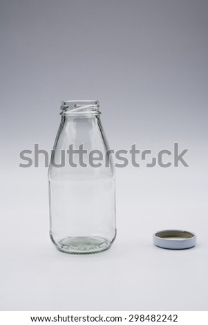 Empty colorless glass bottle on White Background