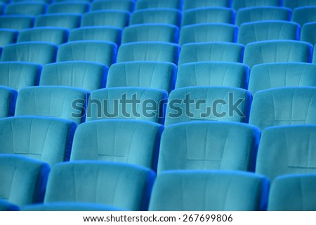 Empty comfortable green seats in theater, cinema - stock photo