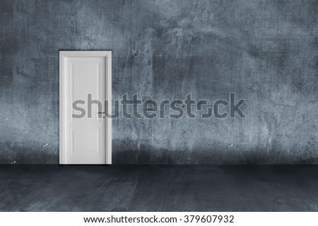 empty concrete room with white door - stock photo