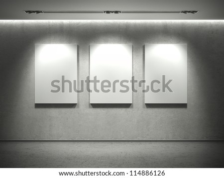 Empty concrete wall with empty frames and 3 spot lights and concrete floor