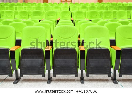 Empty conference hall with green armchairs