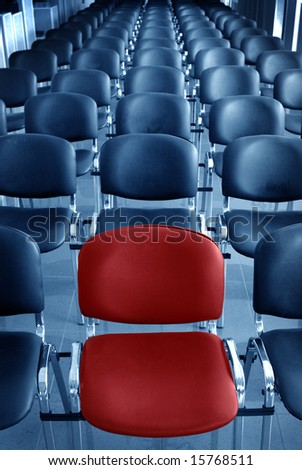Empty conference room with one red chair - stock photo