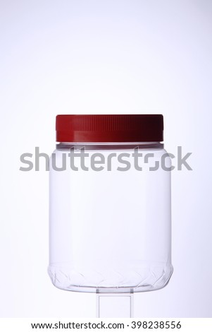 empty cookies container on the white background - stock photo