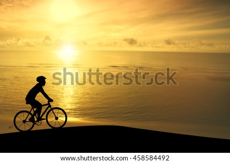 Empty Copy Space Sporty company friends on bicycles outdoors against sunset Silhouette five 1 cyclist going along shoreline coast Reflection sun on water Sport in Nature background Group of people - stock photo