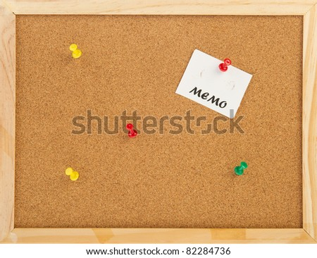 empty cork memo board with wooden frame and pins - stock photo
