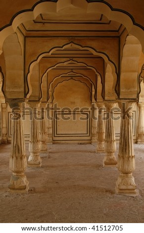 Empty corridor with handcarved pillars in an abandoned Amber Fort. Rajasthan, India