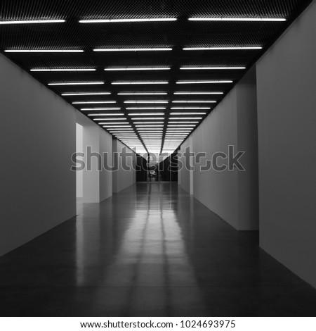 Empty corridor strip lights black white stock photo safe to use empty corridor with strip lights black and white art aloadofball Gallery