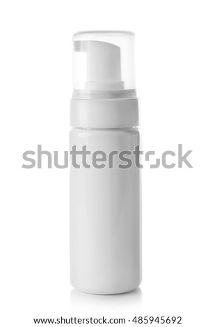 Empty cosmetic bottle on white background