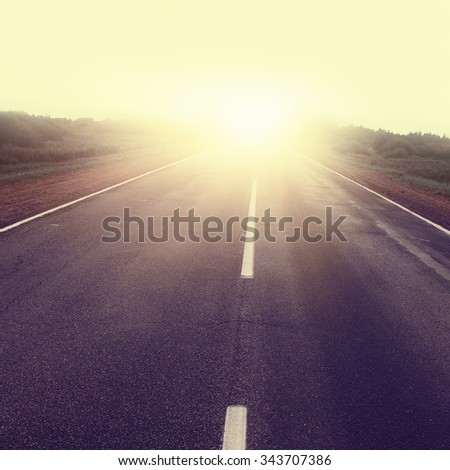 Empty country road at sunset. - stock photo