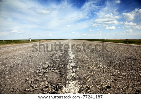 Empty countryside old road. - stock photo