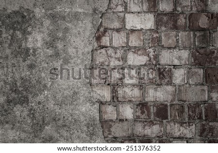 Empty cracked brick wall with copy space - stock photo