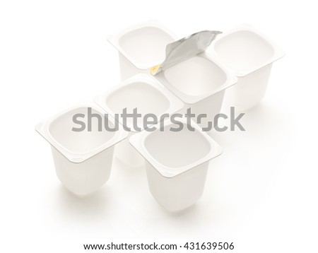 Empty crushed plastic yogurt pots on white - stock photo