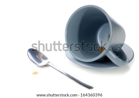 Empty Cup of Coffee with spoon isolate on white background .
