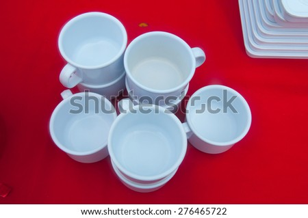 empty cup on red table - stock photo