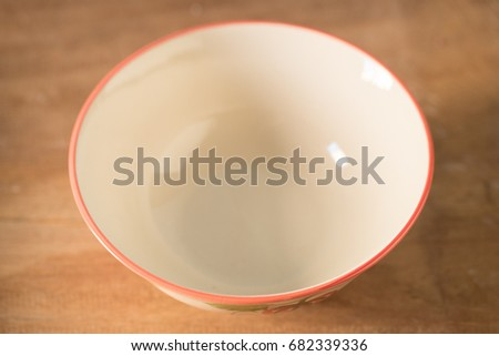 Empty cup on wooden table