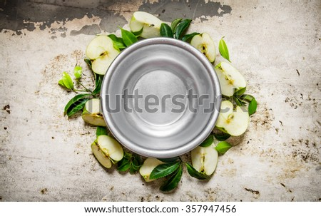 Empty Cup with sliced green apples on  rustic background. Top view - stock photo