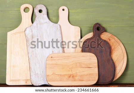 Empty cutting boards on wooden background - stock photo