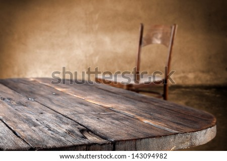 empty dark table and chair in interior - stock photo