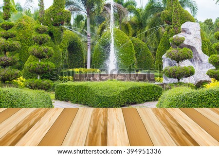 Empty dark wood table with beautiful park in the summer landscape blur background