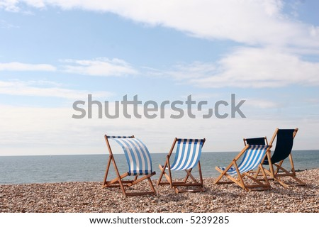 Empty deckchairs on the beach at Bognor Regis Sussex England - stock photo