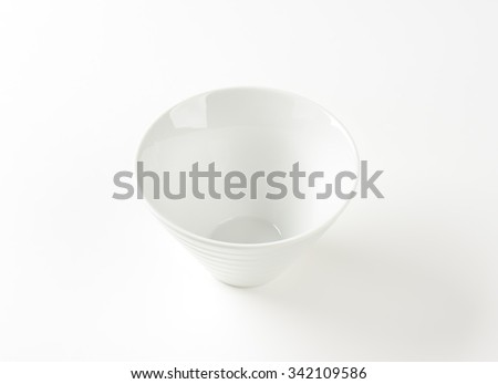 Empty deep white snack bowl, ribbed on the outside