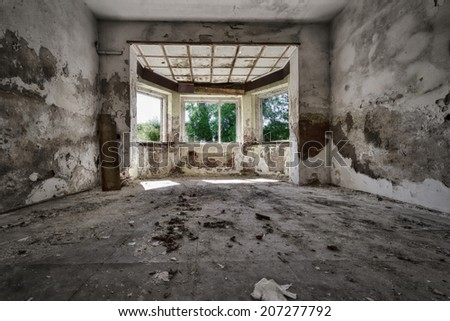Empty destroyed room in an abandoned factory - stock photo