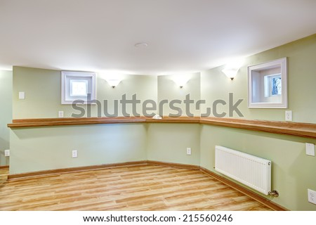 Empty dining area in soft mint color and wood trim. Mother-in-law apartment interior - stock photo