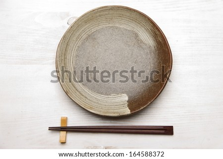 empty dish with chopsticks background