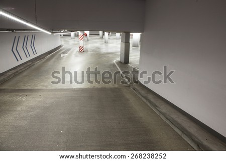 empty driveway in deserted concrete parking garage - stock photo