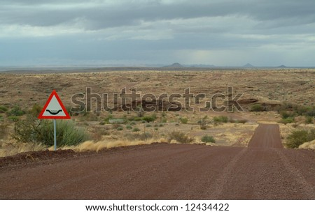 Empty dust road in Namibia Africa - stock photo