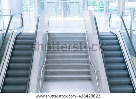 empty escalator and stair - stock photo